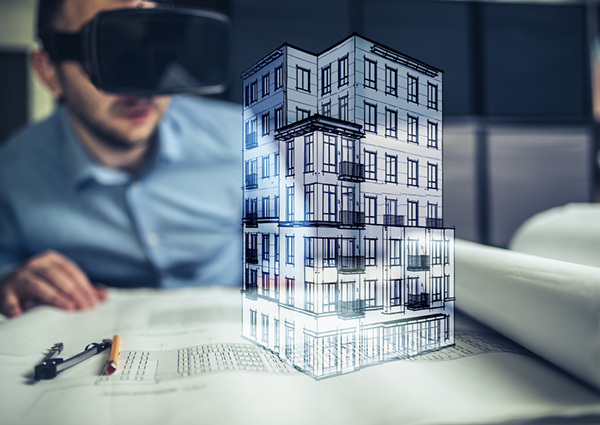 Man looking at a building drawing through AR Goggles