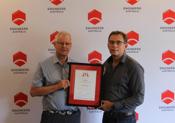 Ian Maitland being awarded EA's highest membership grade an Honorary Fellow by WA President Paul Young