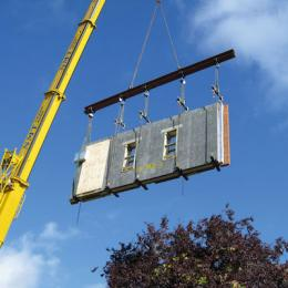 Pre-fabricated walling system being lifted by crane. Photo: Forterra