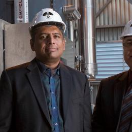 Professor Behdad Moghtaderi (right) with Dr Rajesh Nellore and the Infratech CLES energy system. Photo: University of Newcastle