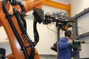 In the KIT Power Tool Test Centre, robots perform automated tests on electric tools just as humans would do. Photo: KIT