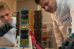 UNSW Canberra scientists working on a Cubesat. Courtesy: UNSW Canberra