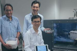 Asst Prof Darren Chian Siau Chen (seated) with fellow team members Asst Prof Anand Sarma (left) and Assoc Prof Vincent Tan. Photo: NUS